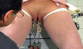 Pussy tortured anent clamps and vibrator